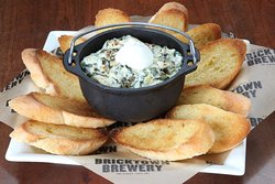 Artichoke & Spinach Dip Artichoke hearts, spinach and a blend of cheeses.  Served with toasted baguettes for dipping.