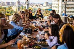 Lunch with friends and wonderful view of the city behind.