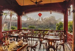 outside dining area - Indochine Restaurant - by the river - alongside the peaceful Nam Khan River at sunset