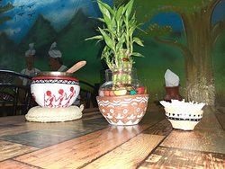 Using worn out earthen pot for decoration - resuse