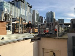 a construction worker on the rooftop