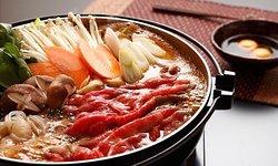 "Japanese traditional Hot Pot ""SUKIYAKI"" with organic vegetables and fresh egg"