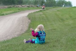 Three year Amelia K. taking a break to watch mom Rachael K pounding laps. Amelia turned 3 yrs in the summer. She was the youngest Rider without training wheels on the amateur tracks.