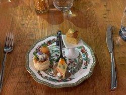 Amuse bouche – salmon mille feuilles, classic Spanish tortilla, velouté with mushroom duxelles, and sour apple bite