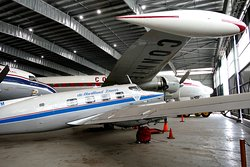 De Havilland DHA-3 Drover under the Constellation wing.
