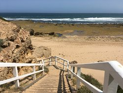 Stairs to ocean beach from lighthouse