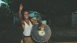 Festival drumming with sticky rice on the drum