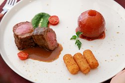 Fillet of beef with steamed pearand demi glace sauce. Opera Cafe. Location: 1st floor, 24/7