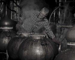 Master Distiller, Dr John Walters, at the stills.