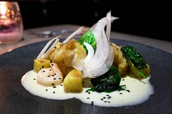 Spiced monkfish with tiger prawns, fennel, coconut, bombay potatoes and spinach.