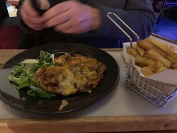 Wednesday Night Visit as  Pudge and Tin busy. Good selection of food, main starting at £6.95. I had original burger with fries and my husband opted for the BBQ hunters chicken. Didn't have to wait long for our food. The burger was defiantly home made, cooked perfectly, thick and juicy. Not much salad on burger. I did mention this and they did offer to bring more salad but I declined. Onion rings were really good but chips were a little greasy. May need to change oil or increase temperature.