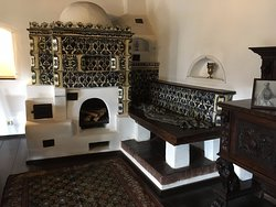 Fireplace with a bench seat close by