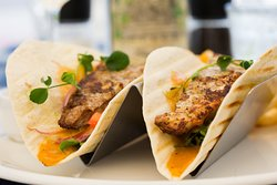 Fish tacos, Cajun spiced snapper, French fries. Served with sour cream & guacamole