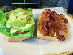 BLT with Avocado on a white toast.
