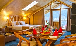 Elegance and style, even for sudden travel needs Royal Cottage Room attached with Jacuzzi. Stunning and stylish for our guests with a love of luxury suite with a private balcony facing Himalayas' make your stay comfortable & unforgettable.