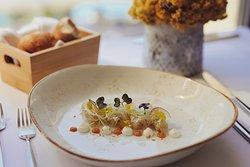 Sea bass sashimi with creme fraiche, scallops coral aioli, spring onion, radish and wasabi caviar