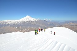 On the top Doberar Peak from Alborz Mountain Range, A real paradise for Skiing in Iran. Mount Damavand (5610m) at the background