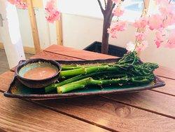 A healthy vegan starter - stir fry tenderstem broccoli with a sesame seed dipping sauce.