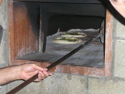 baking focaccia in the brick oven