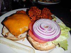 Burger medium rare with sweet potato fries