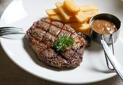 Australian Ribeye Steak served with French fries and creamy mushroom sauce