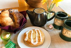 Breakfast in Bed delivery options featuring baked goods from Otter Creek Bakery