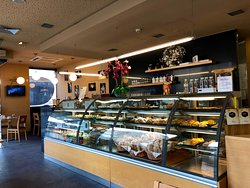 Clean space with lots of options of Portuguese pastries