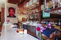 Bar in the entrance room, large fromat celebrity portraits as an element of style