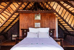 Spend the night under thatch in the Lovebird room