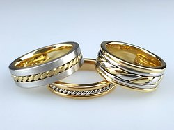 Three handmade men's wedding rings in gold and platinum. These all feature twisted wires.