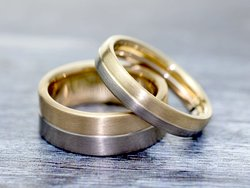 Two  matte-finished wedding rings in 18ct yellow and white gold.