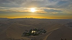 Huacachina Lagoon, an Oasis surrounded by sand dunes and palm trees, a MUST DO option to do in Ica - Peru.