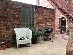 Part of the extremely charming back courtyard patio. Just beautiful.