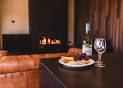 Nothing beats wine and cheese by the cosy fire