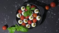 The classic Caprese Salad with our own pesto sauce made in house.
