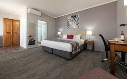 The perfect get away room with a large king bed, plenty of floor space and updated interiors