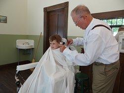 Chop chop in Bousman's Barber Shop.