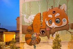 Un mural dell'artista Dulk visibile in via Tempesta, nell'area della Marranella