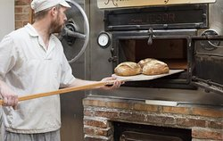 Scott baking bread in the wood fired oven