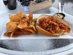 Lobster roll with corn and asparagus relish on the side