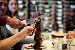 Picanha sirloin carved table-side by our Gaúcho chefs