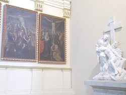 """A sculpture with some big paintings on the wall nearby (in the """"main part"""" of the Cathedral)"""