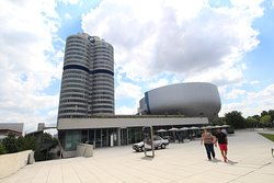 One of the 3 superlative buildings by BMW  The four round towers of the BMW headquarters symbolize the 4 pistons of a BMW engine. Even if this building cannot be visited - to my knowledge. The sight is astonishing and, alongside the BMW Museum and the BMW Welt, is one of the outstanding buildings.  For those interested in cars - especially for those interested in BMW - a highlight in Munich. Enjoy the sight of the towers while visiting BMW and the Olympic Stadium