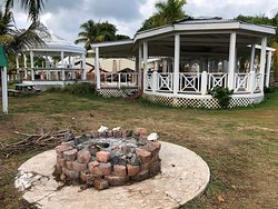 Fire pit near beach and 'dining areas' used by locals in area.  Locals overran the premises, the pool, the beach chairs, the dock, etc.  No security to alert, no one on sight to prevent looting, theft, etc.