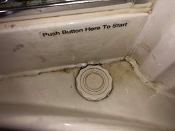 The button to turn on the jacuzzi tub.