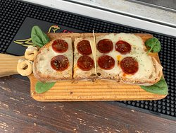 """""""The Portuguese"""" Bruschetta, melted sheep's cheese and black pork sausage"""