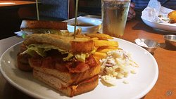 Whitespot club with fries and a side of gravy