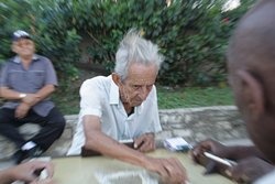 old cuban man playing domino