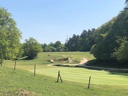 """9th Green on the Forest Course. The 9th hole on the Forest Course was reputed to be on of John Jacobs (OBE) top 18 holes in the world. The hole is named """"King's Garn"""" after the stream running in front of the green."""