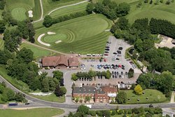 Aerial view of the 18th green on the Manor Course, Clubhouse and adjoining Bell Inn (Sister Hotel)